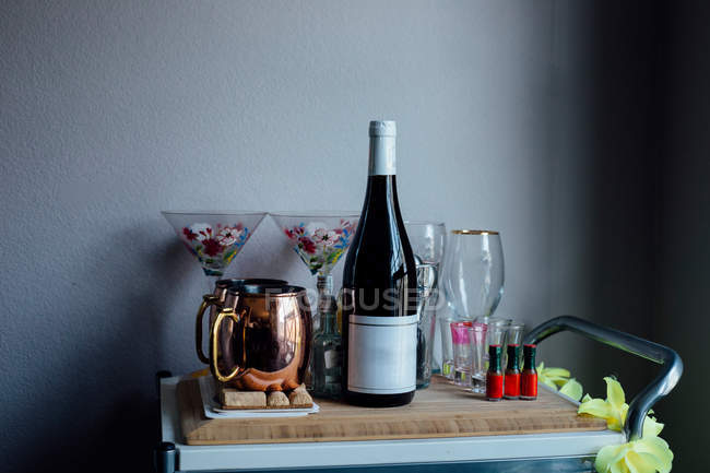 Drinks trolley with wine bottle — Stock Photo