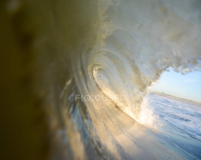 Rolling wave and beach — Stock Photo