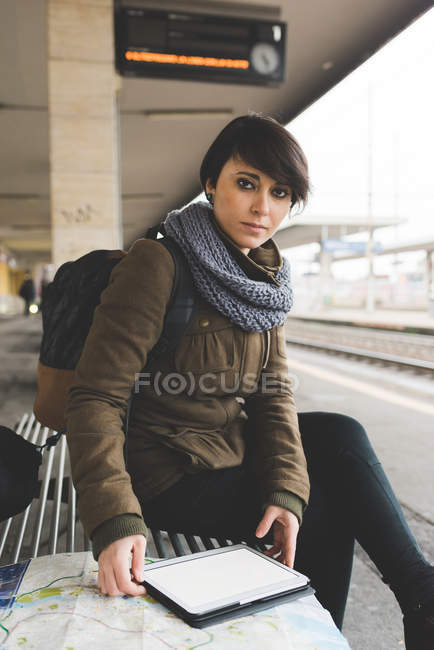 Portrait of female backpacker with map — Stock Photo