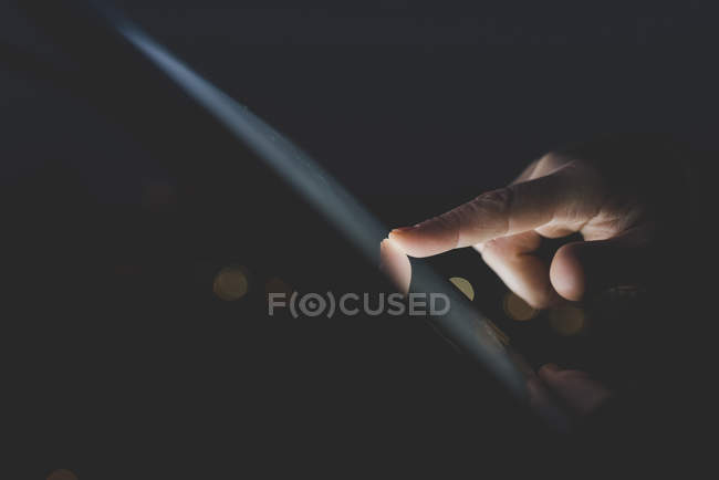 Womans finger using digital tablet — Stock Photo