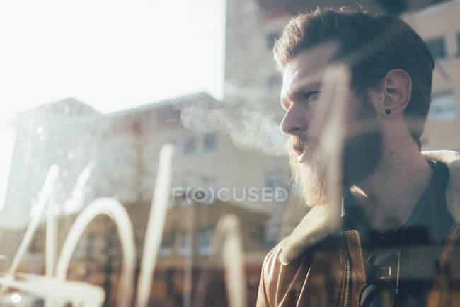Bearded man at city tram station — Stock Photo