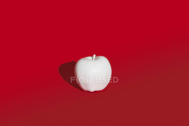 Apple painted white — Stock Photo
