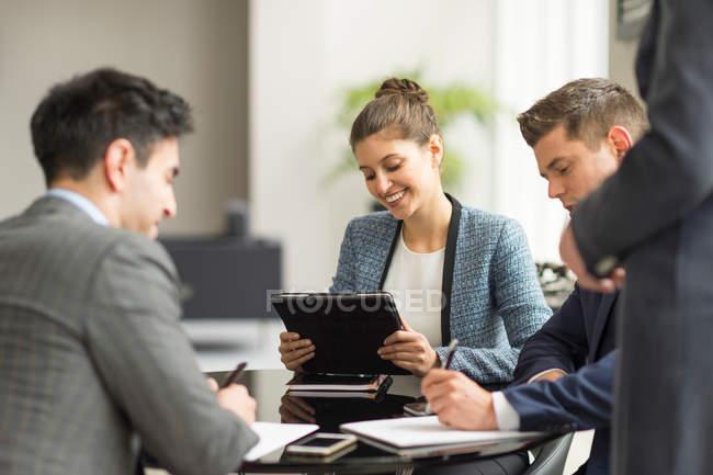 Businessmen and women having office — Stock Photo