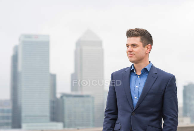 Businessman at office roof terrace — Stock Photo