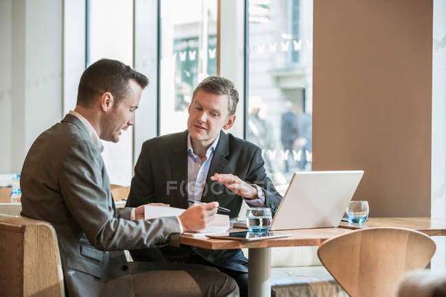 Businessmen working in cafe — Stock Photo