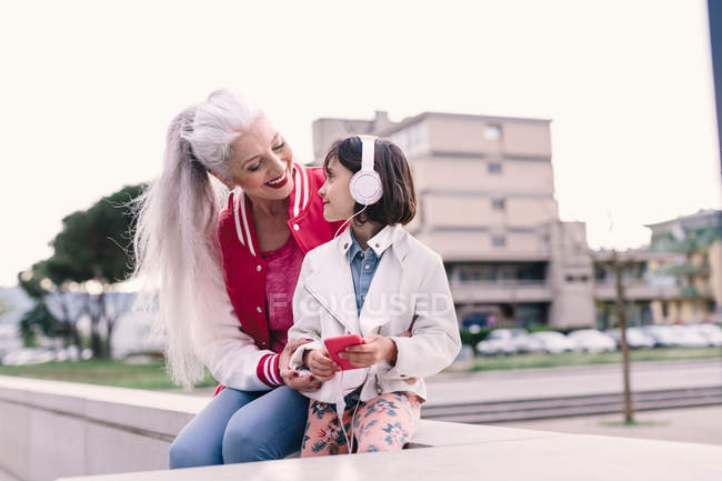 Woman and girl listening music — Stock Photo