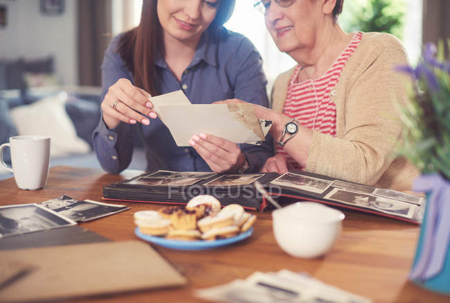 Woman at table with grandmother — Stock Photo