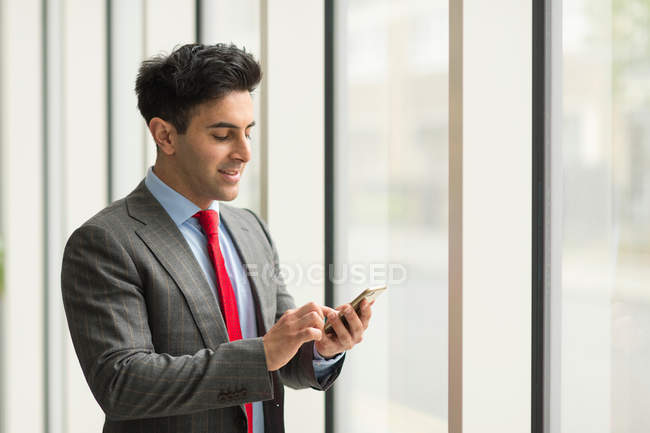 Businessman looking using smartphone touchscreen — Stock Photo