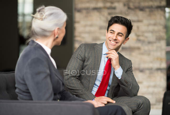 Businessman and woman having meeting — Stock Photo