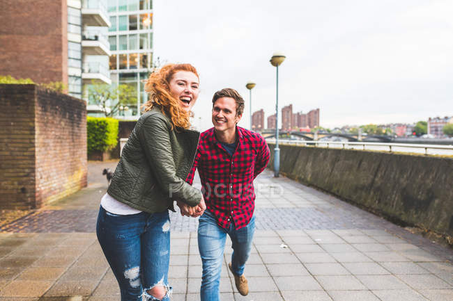 Couple outdoors, fooling around — Stock Photo
