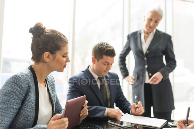 Businessman and women making notes — Stock Photo
