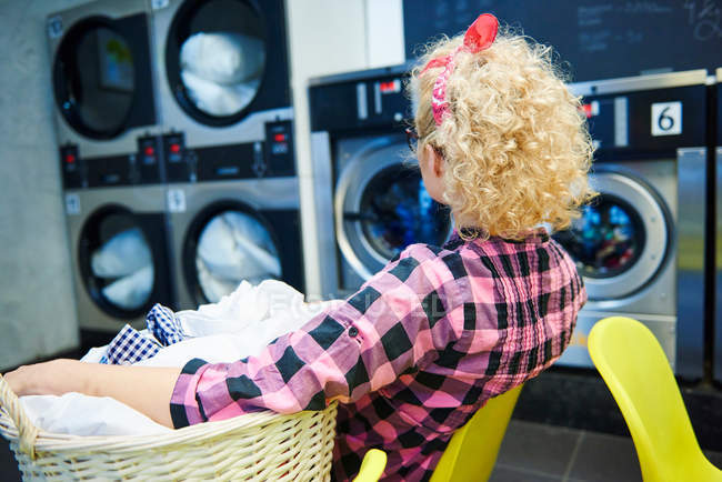 Woman watching washing machines — Stock Photo