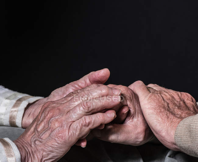 Hands of senior woman and man — Stock Photo
