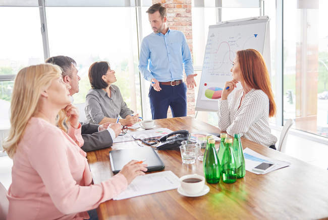 Businessman leading business meeting — Stock Photo
