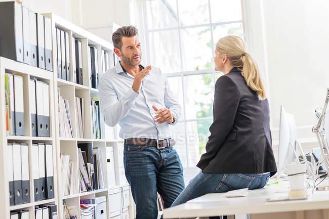 Designer explaining idea to female colleague — Stock Photo