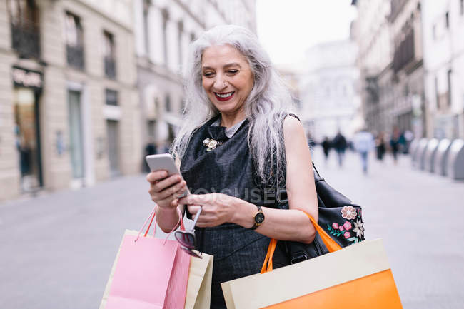 Stylish mature female shopper — Stock Photo
