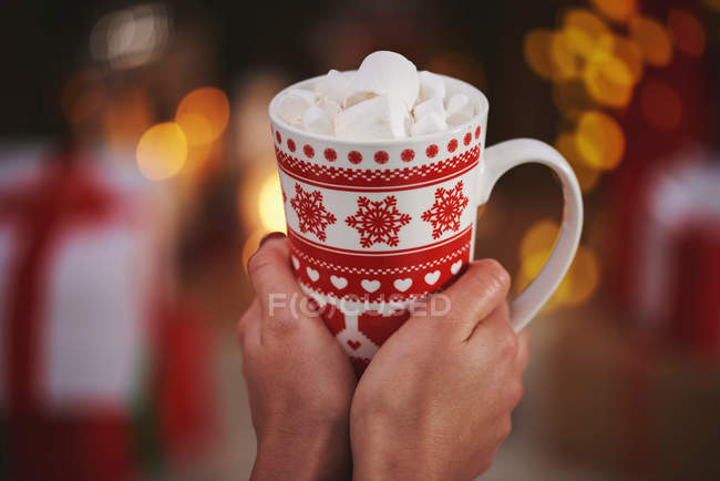 Woman holding hot chocolate — Stock Photo