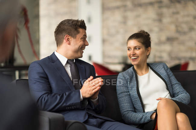 Businesswoman and male colleague — Stock Photo