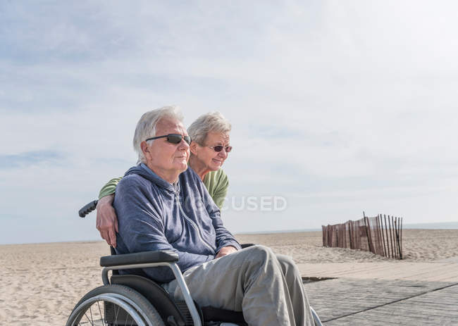 Man in wheelchair with wife — Stock Photo
