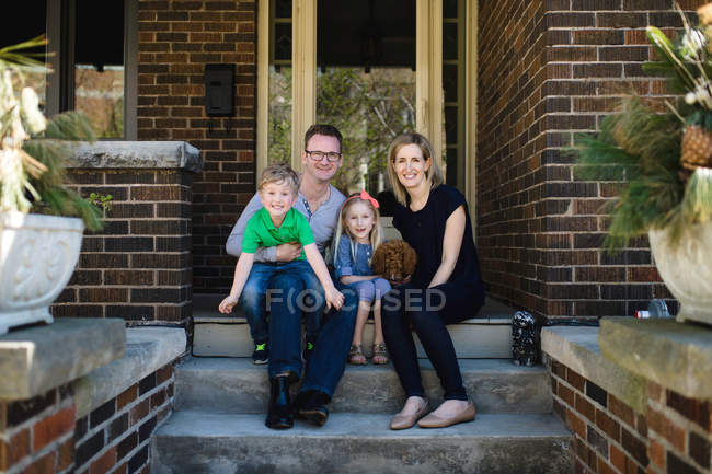 Parents with daughter and son — Stock Photo