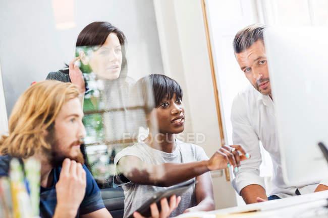 Design team looking at desktop computer — Stock Photo