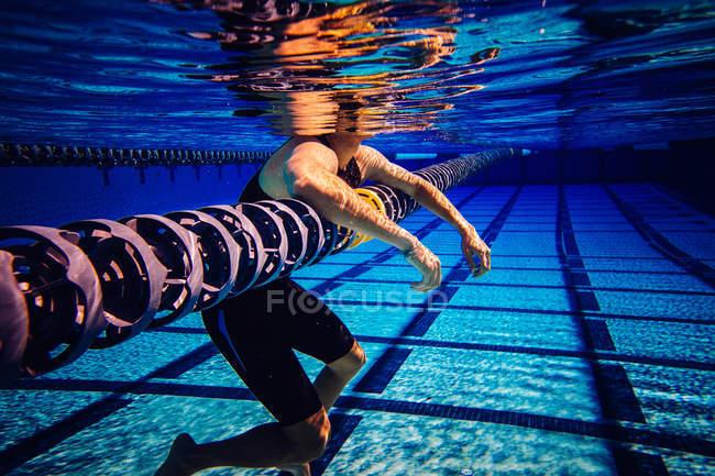 Swimmer resting on lane — Stock Photo