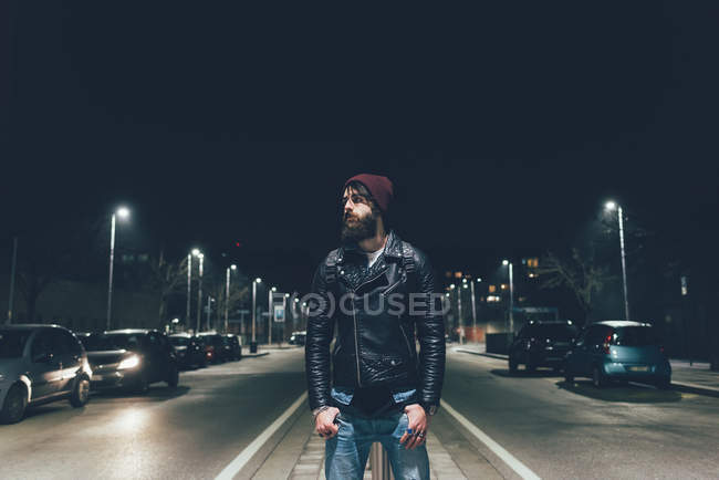 Hipster on city street looking away — Stock Photo
