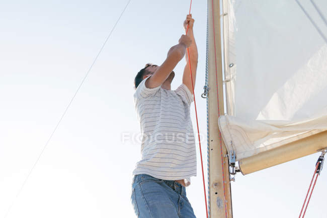Man on sailing boat — Stock Photo