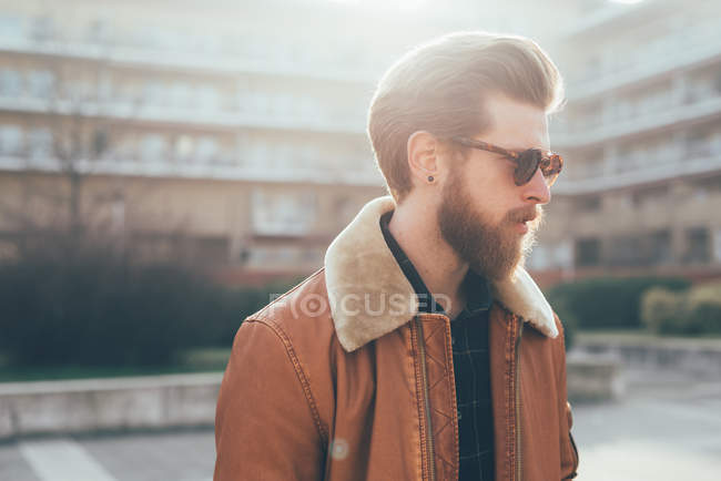Hipster on housing estate — Stock Photo