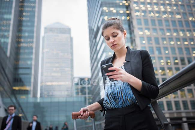 Businesswoman using mobile phone — Stock Photo
