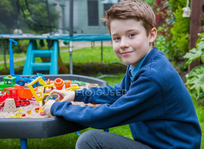 Boy playing in sandpit — Stock Photo