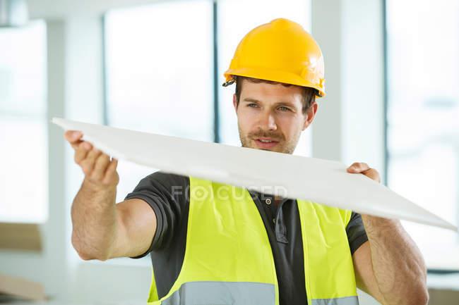 Man wearing hi vis vest — Stock Photo