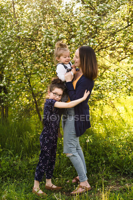Mid adult woman and daughters — Stock Photo
