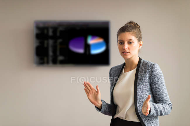 Businesswoman explaining during office presentation — Stock Photo
