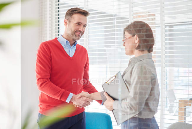 Man shaking hands at job — Stock Photo