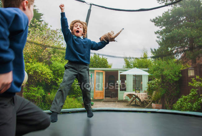 Boys playing on trampoline — Stock Photo