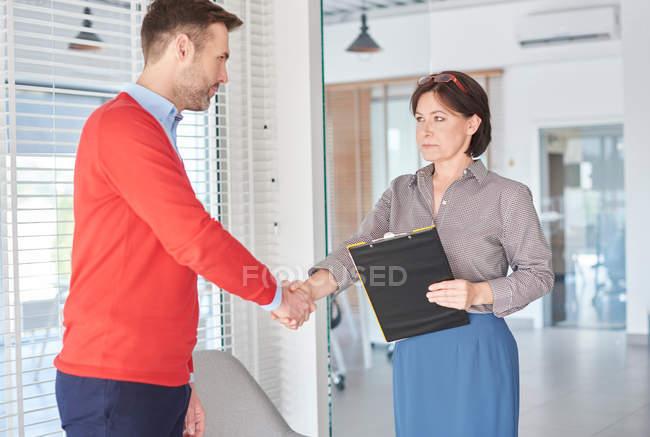 Man shaking hands at job — Stock Photo