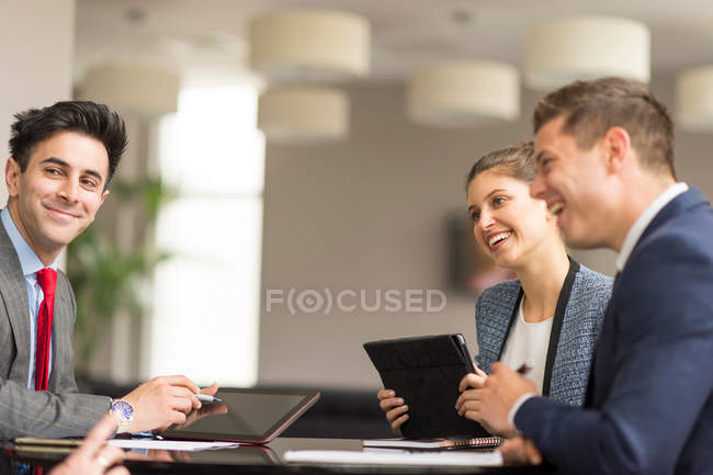 Businesswoman meeting male colleagues — Stock Photo