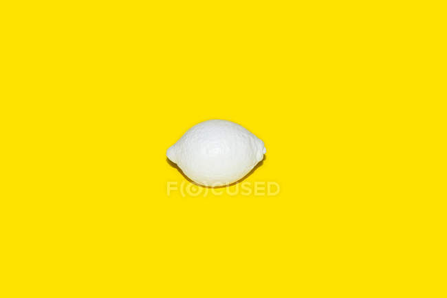 Lemon painted white — Stock Photo