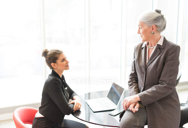 Mature businesswoman and female colleague — Stock Photo