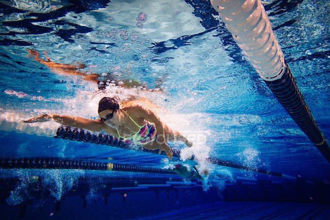 Swimmer doing freestyle in lane — Stock Photo