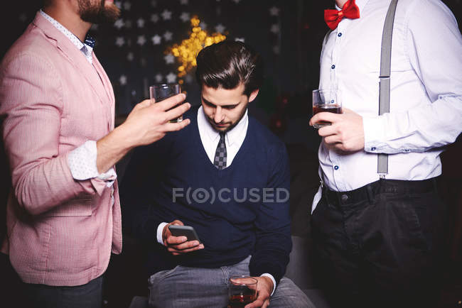 Three men at party — Stock Photo