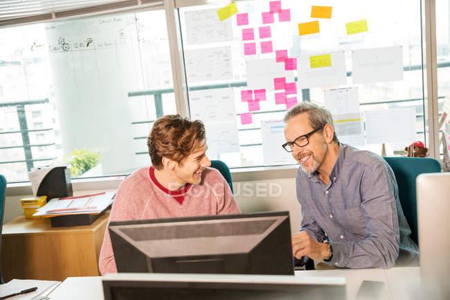 Male digital designer and trainee — Stock Photo