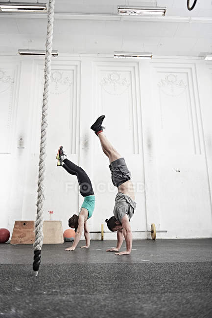 Couple doing handstand — Stock Photo