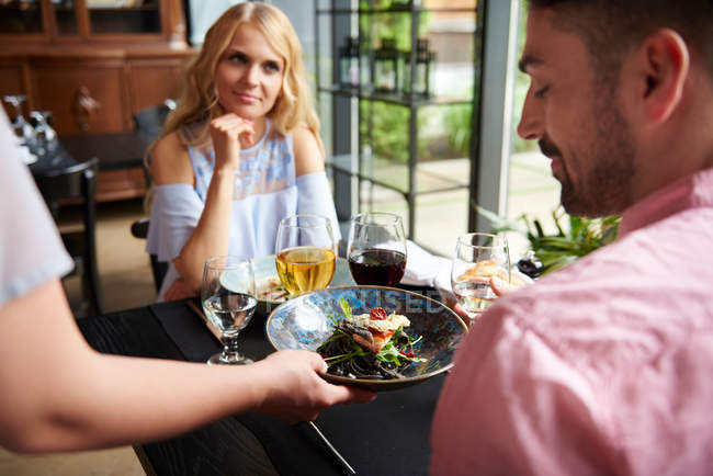 Waitress serving lunch to couple — Stock Photo