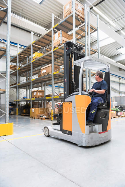 Man driving forklift truck — Stock Photo
