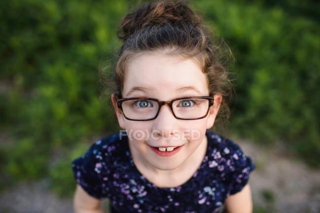 Cute girl wearing eye glasses — Stock Photo