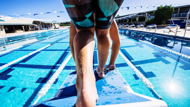 Swimmer on pool diving board — Stock Photo