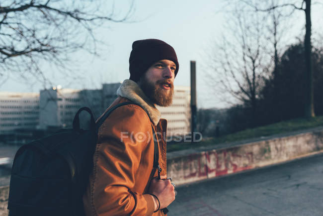 Hipster walking in park — Stock Photo