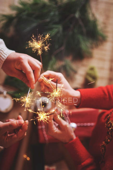 Couple holding indoor sparklers — Stock Photo